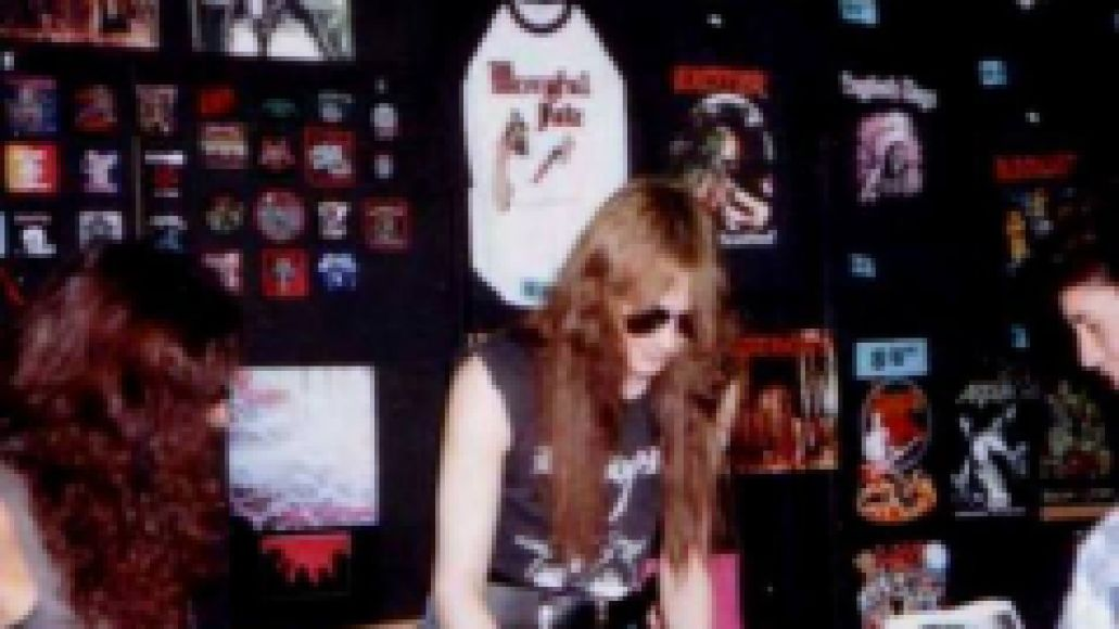 Bathory's Quorthon working the merch table long ago.