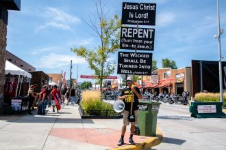 A general view of the atmosphere on Main Street during the 80th annual Sturgis Motorcycle Rally on Saturday, Aug. 15, 2020, in Sturgis, S.D. (Amy Harris)