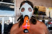 A biker poses for a photo with a gas mask pipe during the 80th annual Sturgis Motorcycle Rally on Saturday, Aug. 15, 2020, in Sturgis, S.D. (Amy Harris)