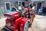 A woman dressed in a bikini poses for a photo at Fat Tony's Bikini Bike Wash & Showers during the 80th annual Sturgis Motorcycle Rally on Friday, Aug. 14, 2020, in Sturgis, S.D. (Amy Harris)