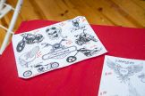 A flash sheet for tattoos sits on a table during the 80th annual Sturgis Motorcycle Rally on Friday, Aug. 14, 2020, in Sturgis, S.D. (Amy Harris)