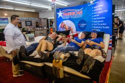People try out a mattress at an exhibit during the 80th annual Sturgis Motorcycle Rally on Friday, Aug. 14, 2020, in Sturgis, S.D. (Amy Harris)