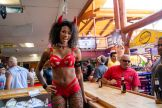 Issie Lewis, a bartender at One Eyed Jacks Saloon poses for a photo during the 80th annual Sturgis Motorcycle Rally on Friday, Aug. 14, 2020, in Sturgis, S.D. (Amy Harris)