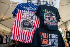 Sturgis T-Shirts are sold in a popup store during the 80th annual Sturgis Motorcycle Rally on Friday, Aug. 14, 2020, in Sturgis, S.D. (Amy Harris)